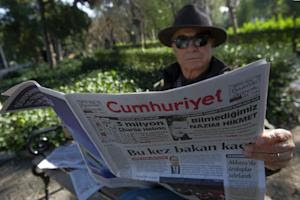 A man reads Cumhuriyet, the leading pro-secular Turkish …