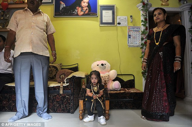 The 18-year-old sits at home in Nagpur, India, in front of a pink teddy bear which looms over her tiny frame