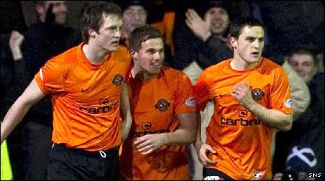 Jon Daly (l) is congratulated on his goal for United