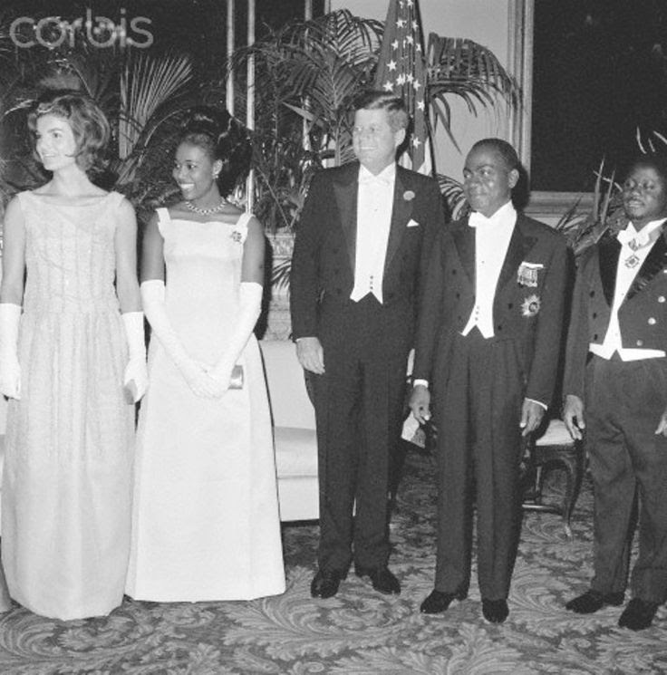 Kennedys and Houphouet-Boignys at State Dinner First Lady Jacqueline Kennedy, Madame Houphouet-Boigny of the Ivory Coast, President John Kennedy, and President Felix Houphouet-Boigny pose for photographers prior to a state dinner at the Mayflower Hotel.  Date Photographed:May 24, 1962✽❤✽❤✽❤✽❤✽   http://en.wikipedia.org/wiki/John_F._Kennedy    http://en.wikipedia.org/wiki/Jacqueline_Kennedy_Onassis