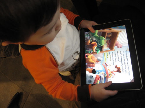 reading toy story on ipad by jencu, on Flickr