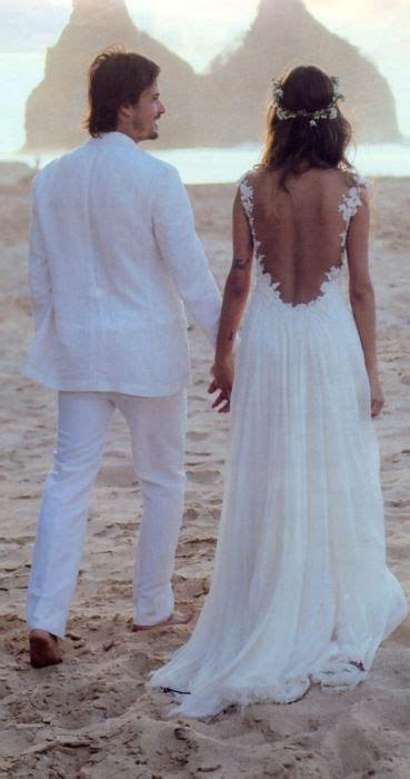 Cute, kind of hippie beach wedding! I LOVE the backless