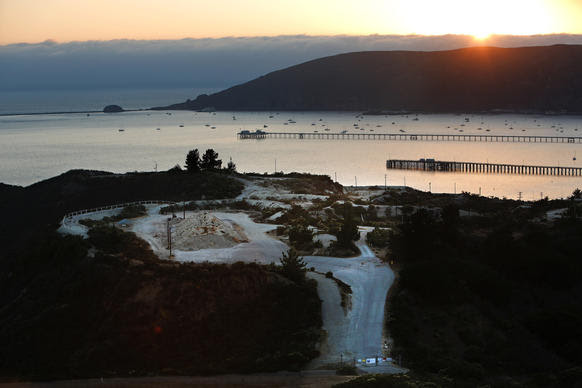 """An aerial view shows the oil tank farm in Avila Beach where Chevron Corp. plans to build an """"intimate resort retreat,"""" including a 100-room hotel, 95 cottages, a spa, restaurants and a seaside amphitheater."""