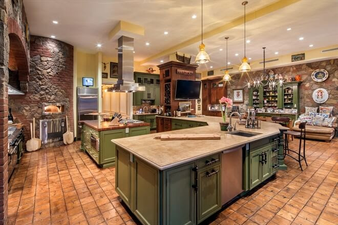 Mediterranean style kitchen with island with variety and hood green cabinets spanish kitchen style zillow