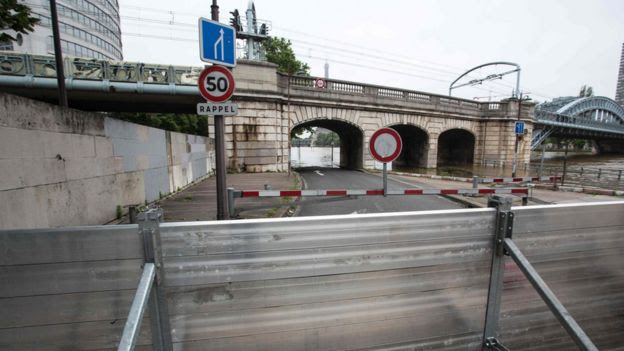Emergency barriers being erected in Paris as flood waters threaten the city