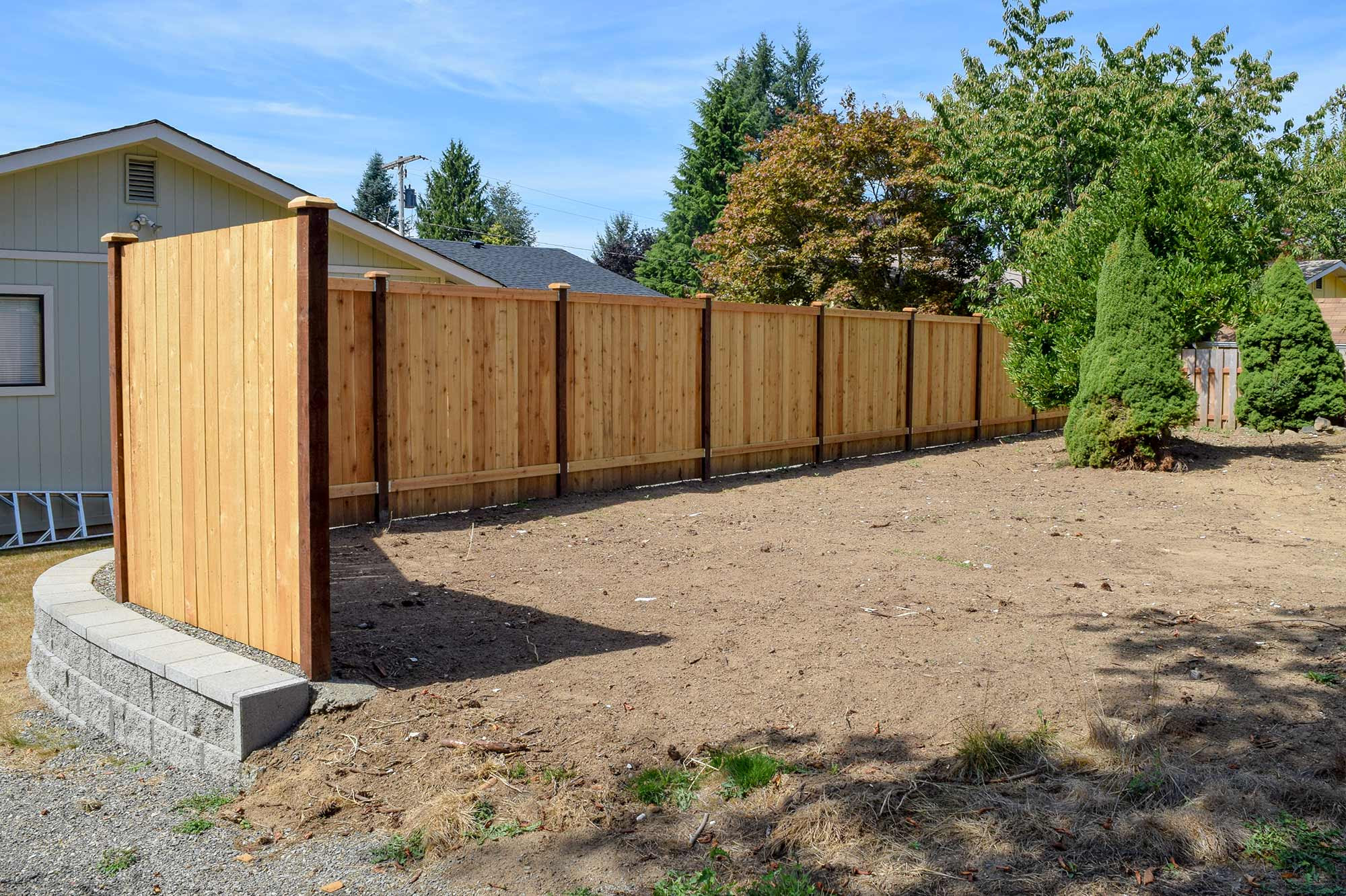 Panhandle Property Divider Fence Retaining Wall in Tumwater AJB