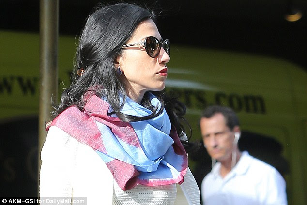 Unhappy together: Huma Abedin and Anthony Weiner were seen on the day DailyMail.com revealed he had sexted a 15-year-old girl, setting off the explosive chain of events leading to the renewed FBI probe