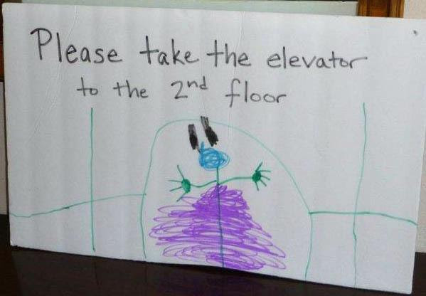 Ellie helped with the elevator sign HomeRome.com