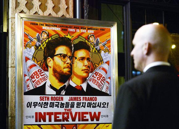 A security guard stands at the entrance of United Artists theater during the premiere of the film ''The Interview'' in Los Angeles, California December 11, 2014.  REUTERS/Kevork Djansezian