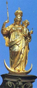 A golden statue of Our Lady holding the Christ Child