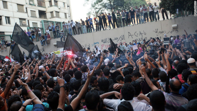 Protesters gather along the U.S. Embassy wall.
