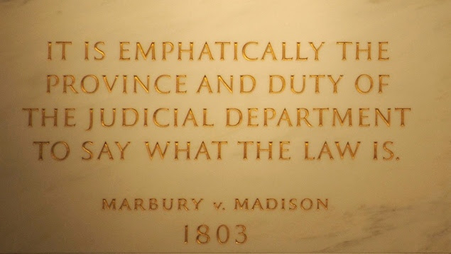 First Floor at the Statute of John Marshall, quotation from Marbury v. Madison (written by Marshall) engraved into the wall. United States Supreme Court Building