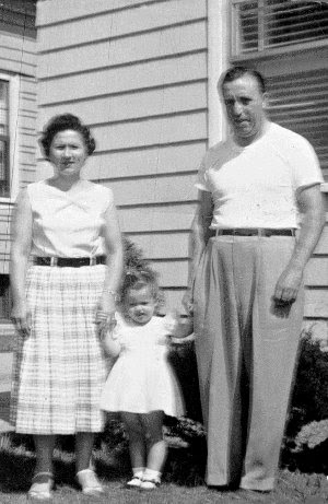 Mom and Dad with little me in the middle