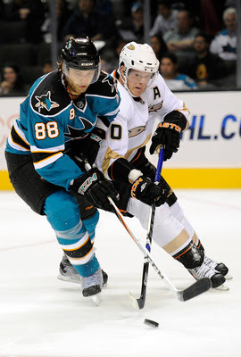 SAN JOSE, CA - SEPTEMBER 23: Brent Burns #88 of the San Jose Sharks fights for the puck with Corey Perry #10 of the Anaheim Ducks in the first period during an NHL Hockey game at HP Pavilion on September 23, 2011 in San Jose, California.  (Photo by Thearo