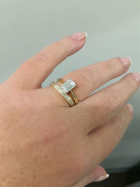 My rings! 1.25 ct emerald cut solitaire with channel set