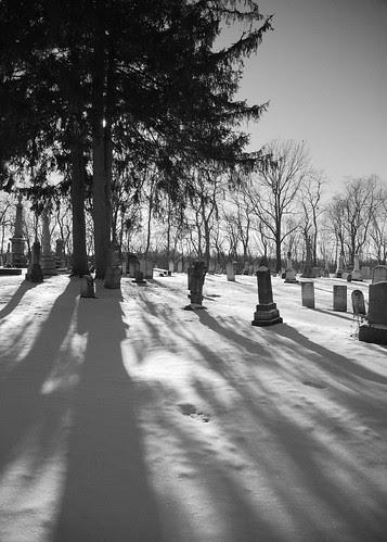 Shadows in a graveyard