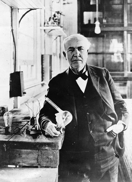 Thomas Edison in his Menlo Park laboratory with one of his inventions, the electric light bulb