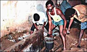 Dalits clearing excreta by hand during the night