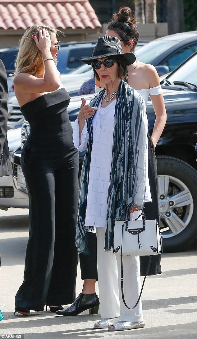 Birthday girl: Kris Jenner's mom MJ, who is celebrating her 82nd birthday, arrived with granddaughters Khloe and Kendall wearing a monochrome ensemble including a funky fedora