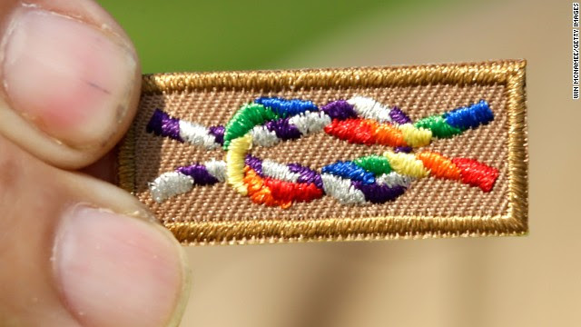 A member of Scouts for Equality holds an unofficial knot patch incorporating the colors of the rainbow, a symbol for gay rights.