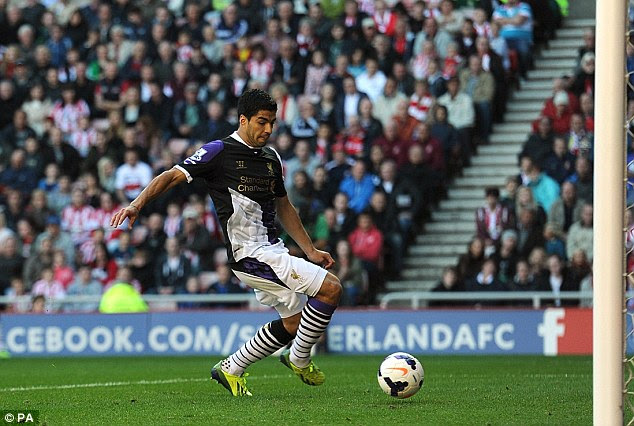 Sliding in: Suarez scores his side's second goal at the back post