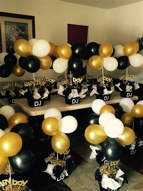 Black and gold babyshower centerpieces   Black and white