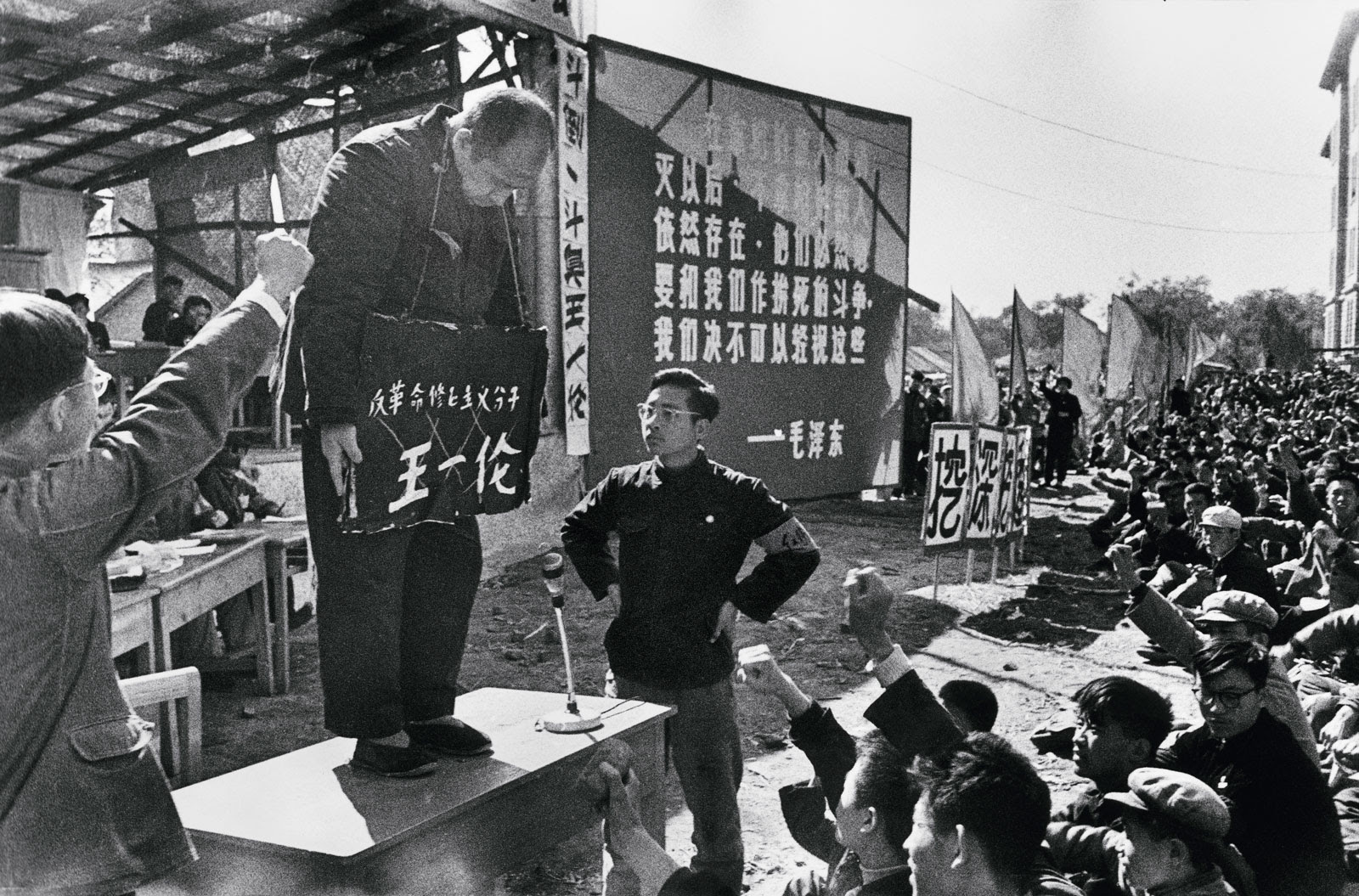 "Provincial Party Secretary Wang Yilun, one of Heilongjiang's most powerful leaders, is criticized by Red Guards from the University of Industry and forced to bear a placard around his neck with the accusation ""counterrevolutionary revisionist element,"" Harbin, northern China, August 23,1966"