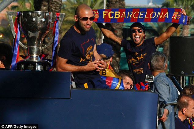 Javier Mascherano (left) and Neymar pictured on top of the Barcelona bus on Sunday
