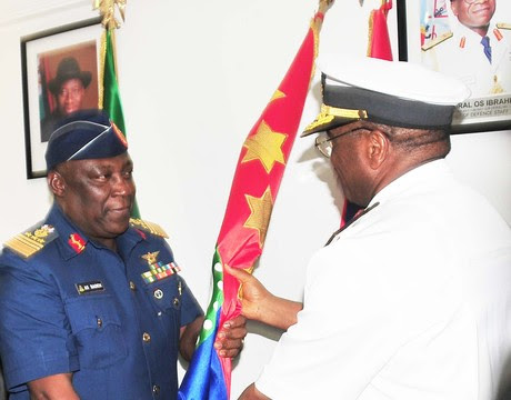 FORMER CHIEF OF AIR STAFF, AIR MARSHAL ALEX BADEH (L), TAKING OVER FROM HIS PREDECESSOR, ADM.  OLA IBRAHIM IN ABUJA ON MONDAY (20/1/14).