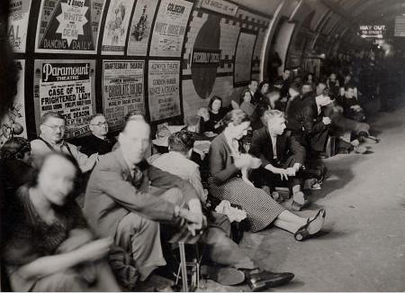 Air raid shelterers on a platform at Piccadilly Circus Underground station - September 1940 - London Transport Museum