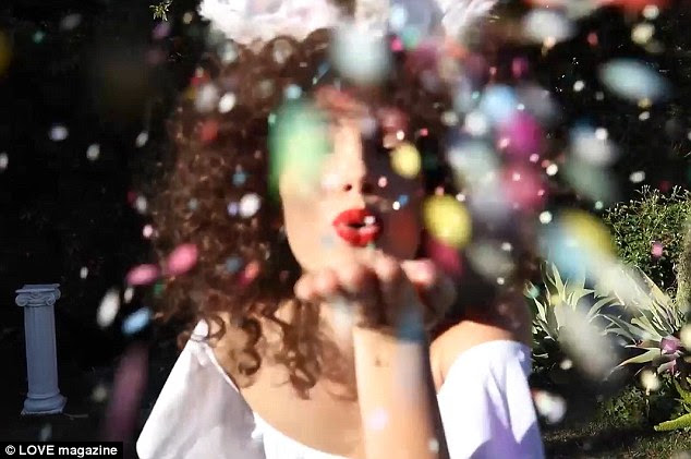 Glitterbomb: Blowing a kiss at the camera with her glossy red lips, Lily danced in clouds of glitter