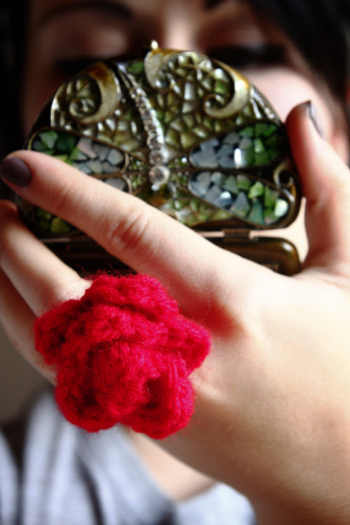 Crochet Rose Ring Tutorial MATERIALS:Yarn in color of choice (I used Red Heart in Cherry Red)3.75mm Crochet HookYarn NeedleScissorsA Blank Ring BackHot glue gun and sticks Pattern:Start by ch 20 Row 1- SC in 2nd CH from hook, CH 1, skip ST, SC in next ST, CH 1, skip ST, repeat across CH 1 and turn Row 2- Insert hook into CH 1 space (SC, HDC, DC, TRC, DC, HDC, SC) repeat in each CH 1 space across Fasten off and pull yarn through leaving a small tail to stitch with. Wrap the strip into a spiral creating a rose as you wrap, position how you want then sew into place using tail. Once you have finished your rose fire up the hot glue gun, glue your rose to your ring blank, let it dry and then wear it out! Hope you like this!