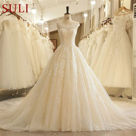 SL 125 Off White Wedding Gowns Open Back Beaded Wedding