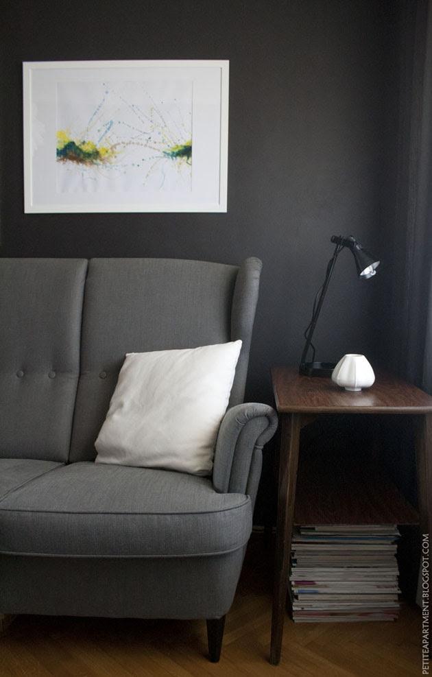 dark grey black living room with grey ikea strandmon sofa mid century modern