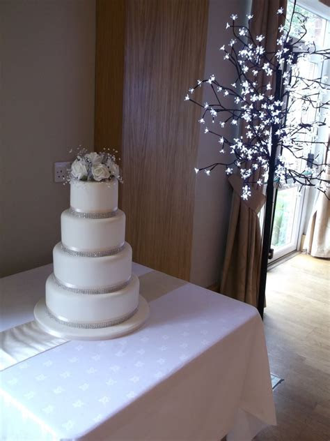 Four Tier Ivory Wedding Cake With Diamante Ribbon And A
