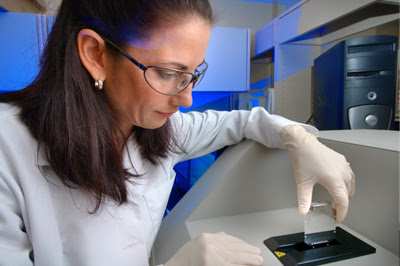 A scientist working with samples in a lab.