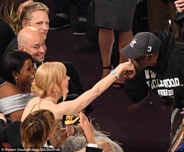 Surprise: Gary Coe was seen kissing the hands of female celebrities after he was invited in by Jimmy Kimmel, including Nicole Kidman. She was nominated for best supporting actress for Lion