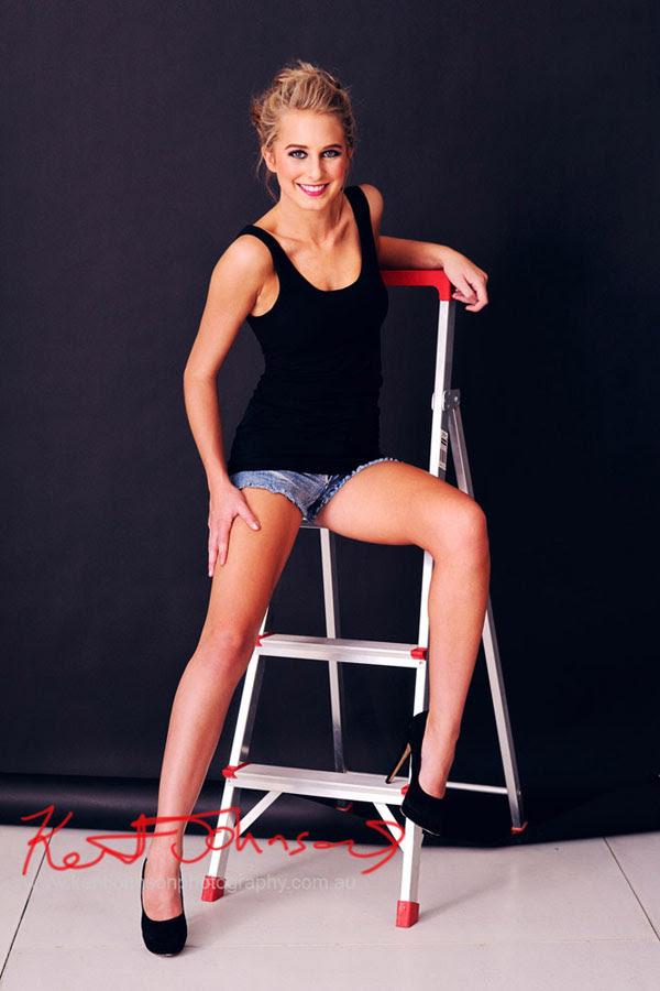 Rachael, Modelling Portfolio, Long legs on ladder on black background