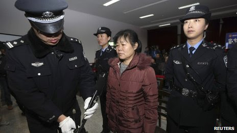 Zhang Shuxia stands trial in Weinan Intermediate People's Court in Weinan, Shaanxi province, 30 December 2013