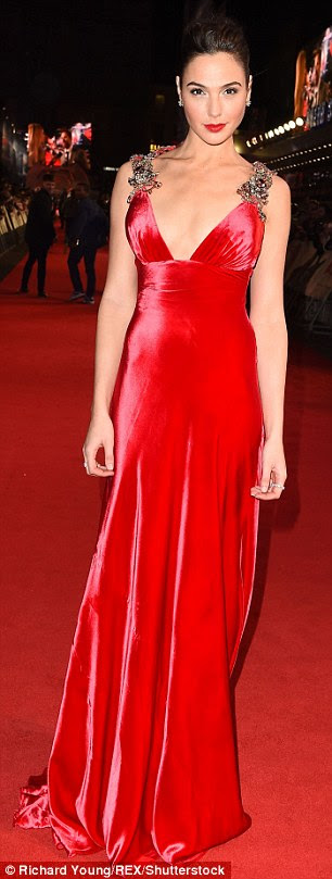 Ravishing in red: The Wonder Woman actress was at risk of blending into the red carpet as the gown was rendered in a similar hue but she avoided such a faux pas