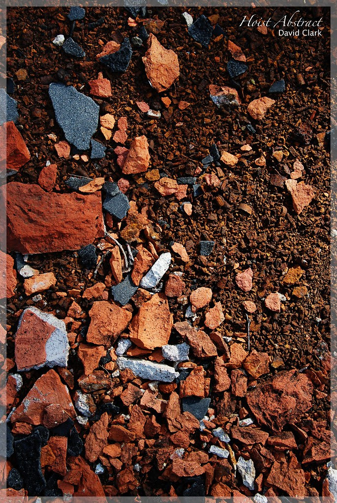 An abstract composition of broken red bricks and dust.