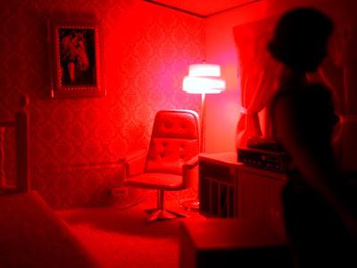Vintage Lundby dolls' house study, lit up at night.