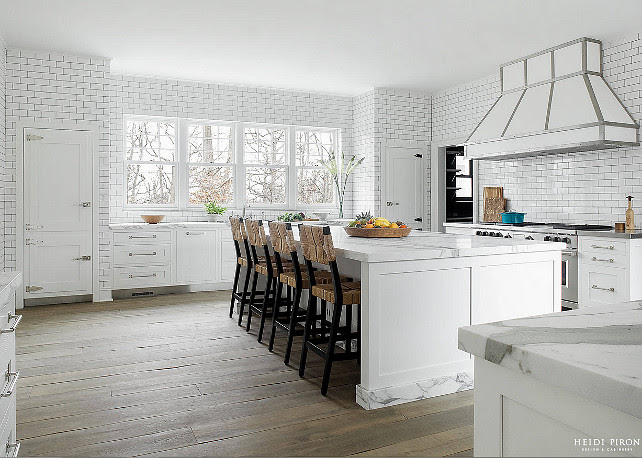 White Transitional Kitchen. White kitchen wity floor-to-ceiling wall tiles. Heidi Piron Design.