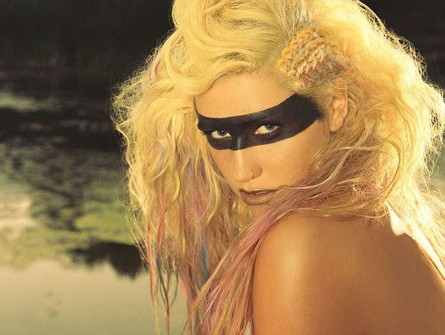 Ke$ha promotes her new album Warrior with provocative