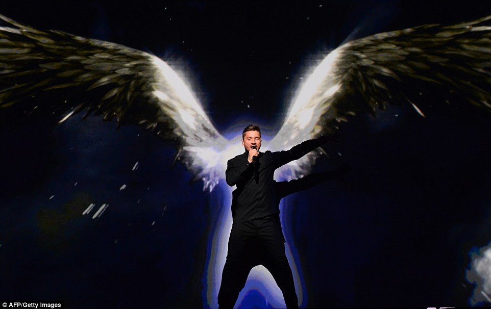 Third in the contest was Sergey Lazarev representing Russia who put on a dramatic performance of his song You Are The Only One full of shadows and feathered silhouettes