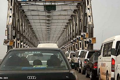 http://www.vanguardngr.com/wp-content/uploads/2014/01/Onitsha-bridge1.jpg