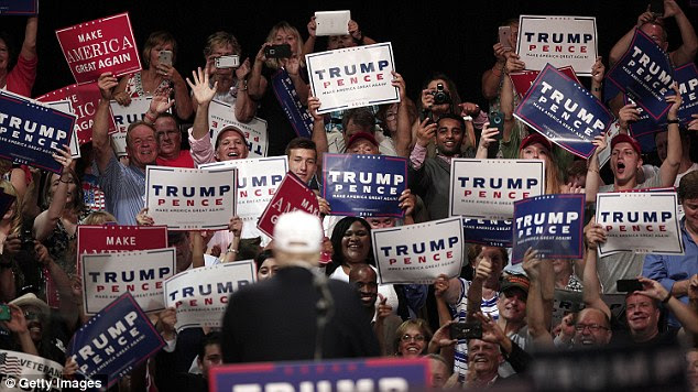 Republican presidential nominee Donald Trump speaks at a campaign rally August 19, 2016 in Dimondale, Michigan. Trump toured flood-ravaged Louisiana earlier in the day