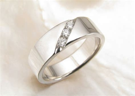 Men's wedding band with channel set diamonds in palladium
