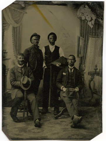 A tintype of four men with blacked faces, 1880s.