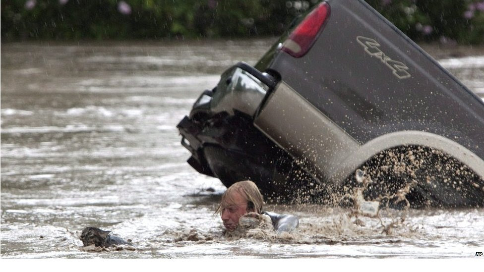 Kevan Yaets swims after his cat Momo to safety in High River, Alberta, Canada on Thursday June 20, 2013.  Both man and cat are reported to be safe and sound after their ordeal.